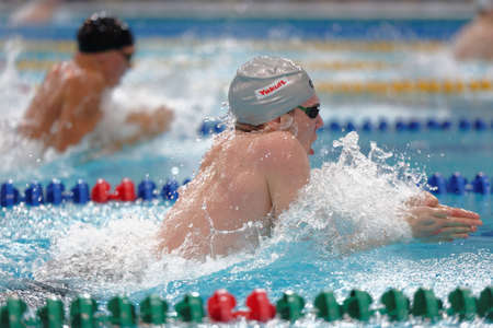 St. Petersburg, Russia - December 16, 2016: Athletes compete in 100 m breaststroke swimming competition during X Salnikov Cup. Athletes from 6 countries participated in the competitions