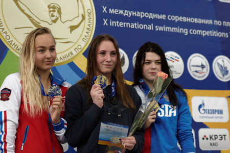 cup of russia: St. Petersburg, Russia - December 16, 2016: Winners of X Salnikov Cup in 800 m freestyle swimming Anastasiia Kirpichnikova (center), Anna Egorova (left) and Varvara Simonova, all from Russia. Athletes from 6 countries participated in the competitions