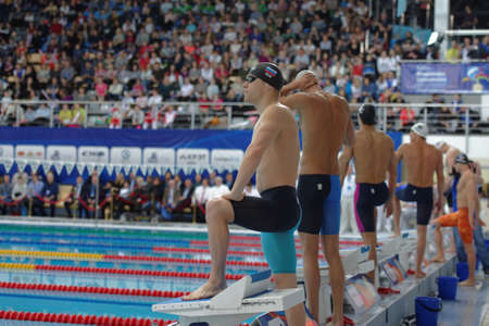 St. Petersburg, Russia - December 16, 2016: Men on the start of 100 m freestyle swimming during X Vladimir Salnikov Cup. Athletes from 6 countries participated in the competitions