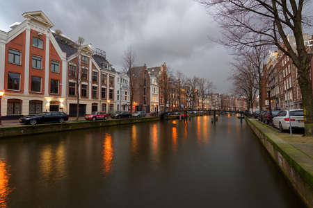 northern light: Amsterdam, Netherlands - January 2, 2017: One of canals in the historical part of city. The 17th-century canal ring area were placed on the UNESCO World Heritage List in 2010 Editorial