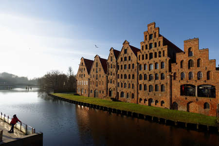 Lubeck, Germany - December 30, 2016: Salt storehouses at the bank of river Trave. Because of its extensive Brick Gothic architecture, the city is listed by UNESCO as a World Heritage Site Editorial