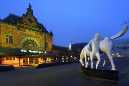 Groningen, Netherlands -December 31, 2016: Sculpture Uncle Loeks Horse in front of the train station. The statue was created by Jan de Baat in 1959 and refers to the popular Groningen folk song