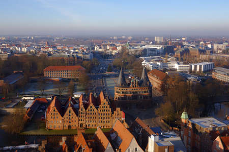 extensive: Lubeck, Germany - December 30, 2016: Cityscape viewed from the tower of St. Peter church. Because of its extensive Brick Gothic architecture, the city is listed by UNESCO as a World Heritage Site