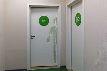 chromosomal: St. Petersburg, Russia - November 16, 2016: Entrance to mens toilet in the building of the biotechnology company BIOCAD. It is one of the world`s few full-cycle drug development and manufacturing companies
