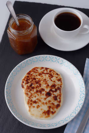 chicouté: Swedish breakfast with mini farmer cheeses, cloudberry jam, and a cup of coffee