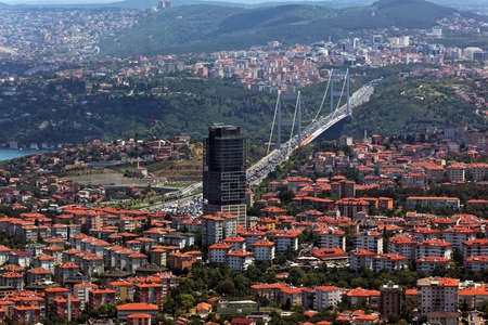 fatih: Istanbul, Turkey - June 30, 2012: Cityscape with Le Meridien Istanbul Etiler hotel and Fatih Sultan Mehmet Bridge. Completed in 1988, is was the second bridge across Bosporus strait Editorial