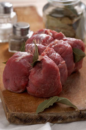 Raw beef meat with bay leaf ready to roast