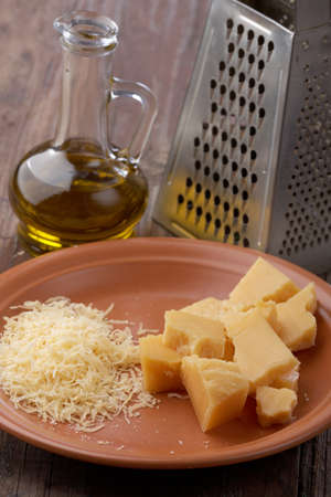 grated parmesan cheese: Grated Parmesan cheese on a rustic table