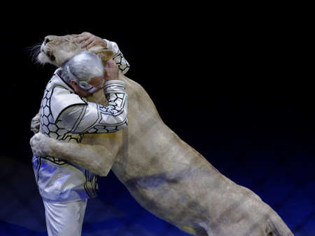 nesterov: St. Petersburg, Russia - February 3, 2017: Sergey Nesterov and his trained lioness in the dress rehearsal of the circus program CircUS 2.0. The program created in the Great Moscow Circus and reflects the vision of circus art of XXI century Editorial