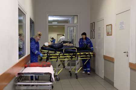january 1: St. Petersburg, Russia - January 30, 2017: Ambulance crew brought the patient to St. Petersburg I.I.Dzhanelidze Research Institute of Emergency Medicine. The institute celebrate its 85th anniversary on February 1 Editorial