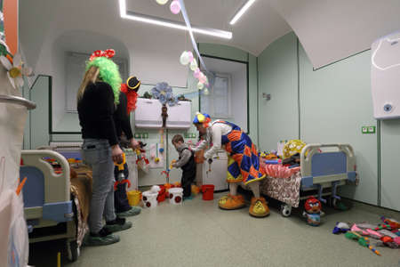 St. Petersburg, Russia - February 16, 2017: Doctor in clown costume examines the child in the St. Magdalena childrens hospital. The hospital was founded in 1829