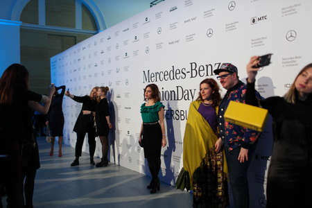 fashion photos: St. Petersburg, Russia - April 1, 2017: People make photos between fashion shows during Mercedes-Benz Fashion Day St. Petersburg. It is one of the most popular fashion events of the city