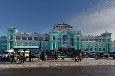 enlarged: Omsk, Russia - February 14, 2015: People in front of the central train station. The  station was founded in 1896 and then several times enlarged and reconstructed Editorial