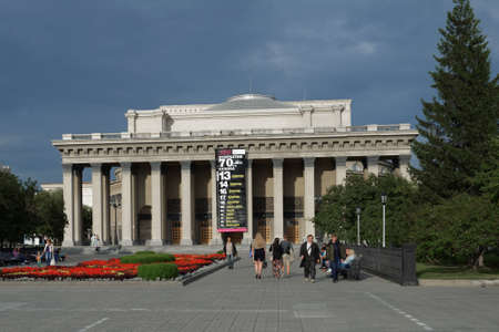 repertoire: Novosibirsk, Russia - July 30, 2014: People in front of the Novosibirsk Opera and Ballet Theater. Its the largest theatrical building in Russia