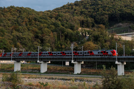 Krasnaya Polyana, Sochi, Russia - September 30, 2015: High-speed train Lastochka on the mountain railroad. Produced by Siemens AG, the train can reach speeds up to 160 kmh