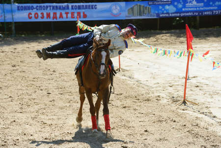 Lytkarino, Moscow region, Russia - July 12, 2014: Rider performs stunts during Russian championship in trick riding. Lytkarino housed the Russian Federation of trick riding