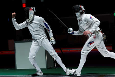 Kiev, Ukraine - April 14, 2012: One of fights during World Fencing Championship. It was the only events were the womens team sabre and mens epee team in 2012 Editorial