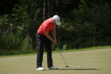 Tseleevo, Moscow region, Russia - July 26, 2014: David Horsey of England in action in the Tseleevo Golf & Polo Club during the 3rd round of M2M Russian Open. This international golf tournament is the stage of the European Tour