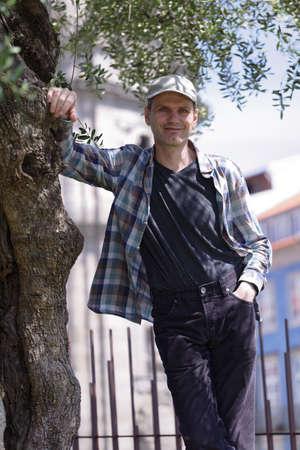 Mature tourist under the tree in Porto, Portugal photo