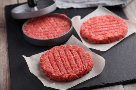 Cooking beef hamburgers from minced meat with meat press
