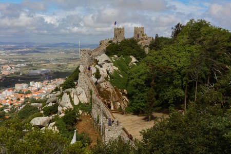 Sintra, Portugal - May 10, 2017: Tourists ascending to the Castle of the Moors. Since 1995, the cultural landscape of Sintra is listed as UNESCO World Heritage