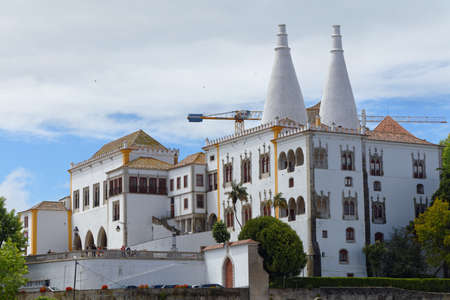 Sintra, Portugal - May 10, 2017: the National Palace of Sintra, the best-preserved medieval royal residence in Portugal. Since 1995, the cultural landscape of Sintra is listed as UNESCO World Heritage