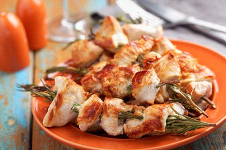 Chicken souvlaki on rosemary sticks closeup
