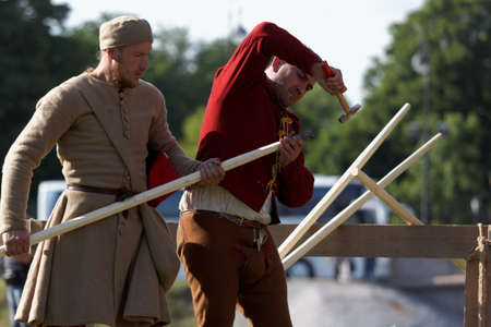 reenactment: St. Petersburg, Russia - July 9, 2017: Participants preparing a lance for jousting tournament during the military history project Battle On Neva at St. Peter and Paul fortress. Its the 4th such event