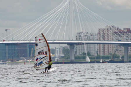 St. Petersburg, Russia - July 5, 2017: Windsurging training in the Gulf of Finland near the yacht club of St. Petersburg. Sponsored by Gazprom, yacht club organises sailing classes for all ages and holds sports regattas Editorial