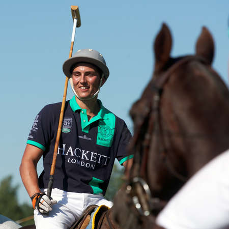Tseleevo, Moscow region, Russia - July 26, 2014: Alexander Rose of Oxbridge Polo Team in action during the match against the Tseleevo Polo Club during the British Polo Day. Oxbridge won 5-4