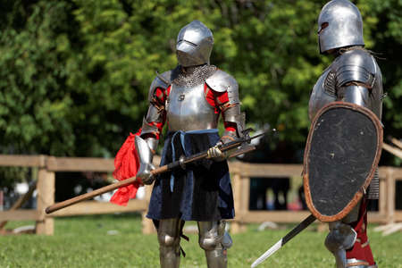 St. Petersburg, Russia - July 9, 2017: Armored knights preparing to the tournament during the military history project Battle On Neva at St. Peter and Paul fortress. Its the 4th such an event Editorial