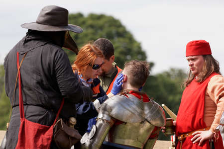 St. Petersburg, Russia - July 8, 2017: Emergency team help to participant of the jousting tournament during the military history project Battle On Neva at St. Peter and Paul fortress. Its the 4th such event