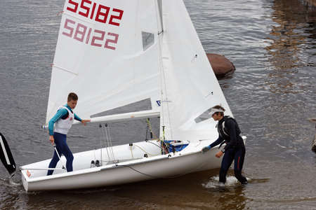 St. Petersburg, Russia - July 5, 2017: Training in sailing on 420 dinghy in the Gulf of Finland near the yacht club of St. Petersburg. Sponsored by Gazprom, yacht club organises sailing classes for all ages and holds sports regattas
