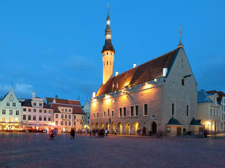 Tallinn, Estonia - July 30, 2017: People on the Town Hall square in the night. The Old Town is one of the best preserved medieval cities in Europe and is listed as a UNESCO World Heritage Site Editorial