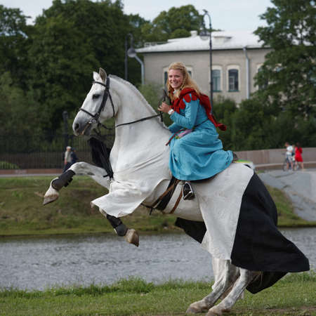 St. Petersburg, Russia - July 9, 2017: Women in medieval clothes on a horse during the military history project Battle On Neva at St. Peter and Paul fortress. The main event this year is jousting tournament Editöryel