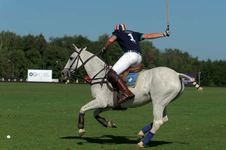 Tseleevo, Moscow region, Russia - July 26, 2014: Tom Hudson of Oxbridge Polo Team in action during the match against the Tseleevo Polo Club during the British Polo Day. Oxbridge won 5-4