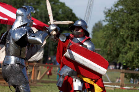 St. Petersburg, Russia - July 9, 2017: Armored knight fighting in the tournament during the military history project Battle On Neva at St. Peter and Paul fortress. Its the 4th such an event