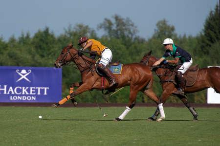 Tseleevo, Moscow region, Russia - July 26, 2014: Match Tseleevo Polo Club - Oxbridge Polo Team during the British Polo Day. Oxbridge won 5-4 Stock Photo - 84696386