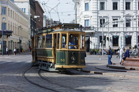 Helsinki, Finland - July 29, 2017: Retro tram on Kauppatori, Market Square in a summer day. The car made in 1909 is now used as sightseeing tram route Editorial