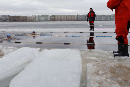 St. Petersburg, Russia - March 18, 2017: People participate in the winter swimming competitions in river Neva at St. Peter and Paul fortress. The event aimed to revive the winter swimming tradition dated back to 1960-1990s Editöryel