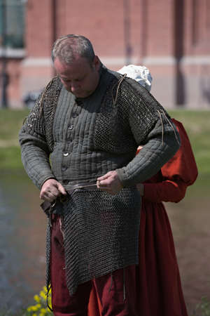 St. Petersburg, Russia - July 8, 2017: Participant of armored knight tournament preparing to the battle during the military history project Battle On Neva at St. Peter and Paul fortress. Its the 4th such event