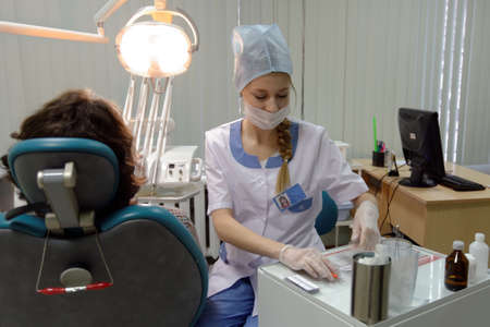 Novosibirsk, Russia - December 4, 2014: Dentist at work in the Health Center. Health Centers are operated since 2010 and aimed to disease prevention Editöryel
