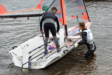 St. Petersburg, Russia - July 5, 2017: Training in sailing on 29er dinghy in the Gulf of Finland near the yacht club of St. Petersburg. Sponsored by Gazprom, yacht club organises sailing classes for all ages and holds sports regattas Editorial