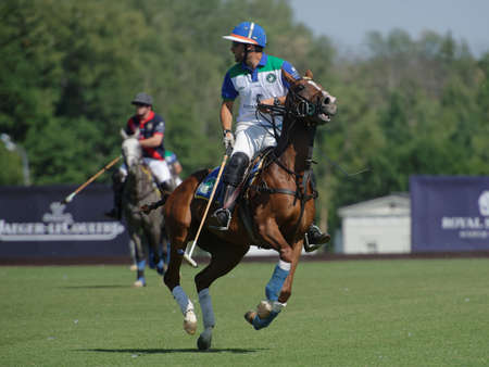 Tseleevo, Moscow region, Russia - July 26, 2014: Misha Rodzianko of Moscow Polo Club in action in the match against British Schools during the British Polo Day. Moscow Polo Club won 7-6