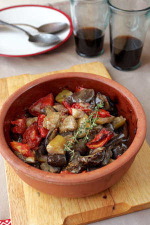 Ratatouille in a pot and red wine