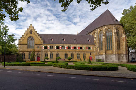 Maastricht, Netherlands - September 8, 2013: Building of Kruisherenhotel viewed from Kommel street. The hotel housed in the restored Gothic monastery and provide luxury service