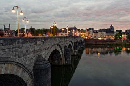 Maastricht, Netherlands - September 7, 2013: Sint-Servaasbrug, the bridge of St. Servatius across the Meuse river in evening. Built in XIII century, it considered as the oldest Dutch bridge