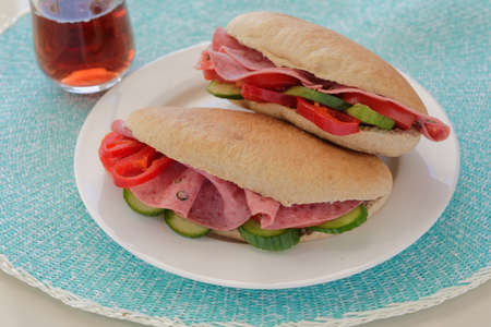 Sandwiches with pita bread, Bologna sausage, and vegetables
