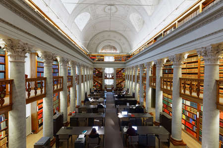 Helsinki, Finland - November 6, 2017: People in the National Library of Finland. The building was erected in 1832 by design of the architect Carl Ludvig Engel Editöryel