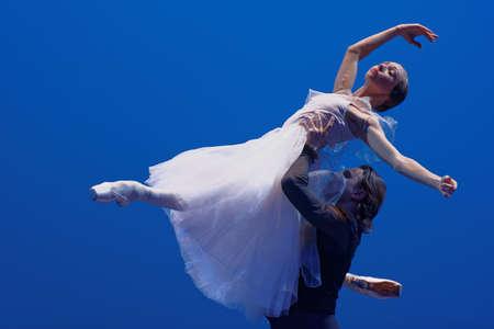 St. Petersburg, Russia - November 16, 2017: Ballet soloists of Mariinsky theater Yekaterina Osmolkina and Anton Korsakov perform during gala concert of Oleg Vinogradov. Great choreographer celebrated his 80th anniversary